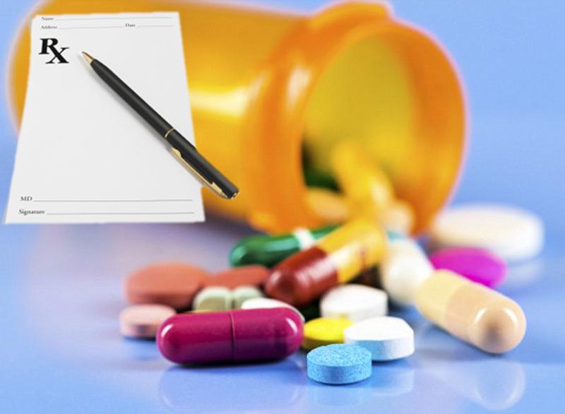 1414595777823_wps_25_Pills_and_open_bottle_stu