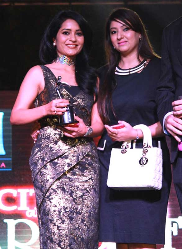 Charyl-Malik-with-Award