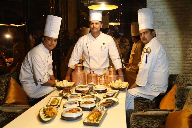 L-R-Chef-Ravinder-(junior-sous-chef),-Chef-Naveen-Handa-(Executive-Chef)-and-Chef-Ravinder-(Sous-Chef)-presenting-the-new-Menu-at-Saffron