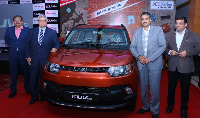Second-from-Left---Mr-Vivek-Nayer-Chief-Marketing-Officer,-Automotive-Division,-Mahindra-&-Mahindra-Ltd-during--the-launch-of-KUV-100-at-Hotel-Taj-Chandigarh-on-Tuesday
