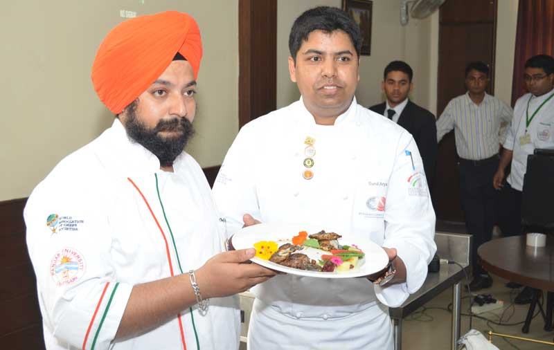 Chef-Jaswinder-and-Chef-Sunil-Arya-with-Black-Chicken-preparation