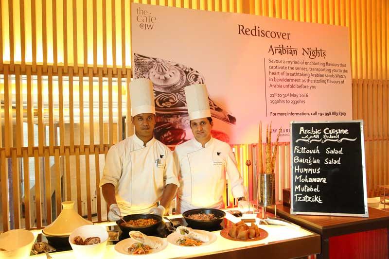 L-R--Chef-Debashish-Biswas-and-Chef-Vijay-Prakash-displaying-food-to-be-served-at-Arabian-Nights,-Arabian-Food-festival-at-JW-Marriott-Chandigarh