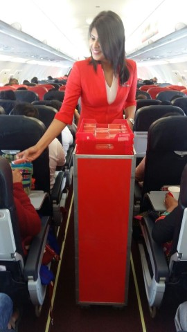 Cabin Crew distributing chocholates to guests on board AirAsia India flights (Small)