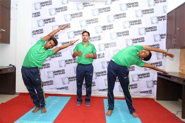Sanjeev Tyagi, a yoga instructor conducting a yoga session at Advanced Hair Studio in Ludhiana (2) (Small)
