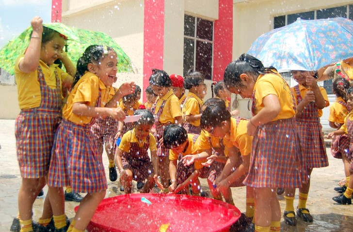 Students of The Holy Wonder Smart School enjoyed unprecedented rain at its campus (Small)