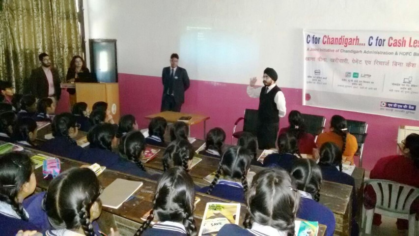 an-hdfc-bank-official-demonstrates-the-benefits-of-using-netbanking-mobile-banking-upi-ussd-and-mobile-apps-such-as-payzapp-and-chillr-at-a-school-in-chandigarh-small