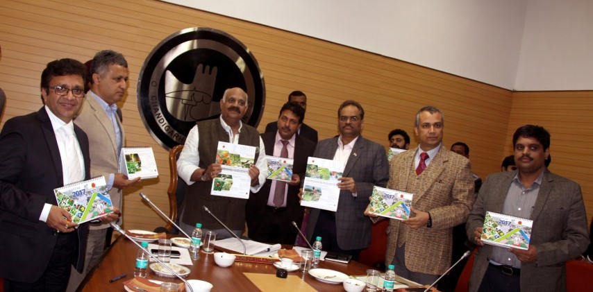 """The Governor of Punjab and Administrator, Union Territory, Chandigarh, Shri V.P. Singh Badnore alongwith the Adviser to the Administrator, UT, Chandigarh, Shri Parimal Rai and senior officers releasing """"Table Calender-2017"""" of Forest Department, Chandigarh Administration at UT Secretariat, Chandigarh on Tuesday, January 03, 2017."""