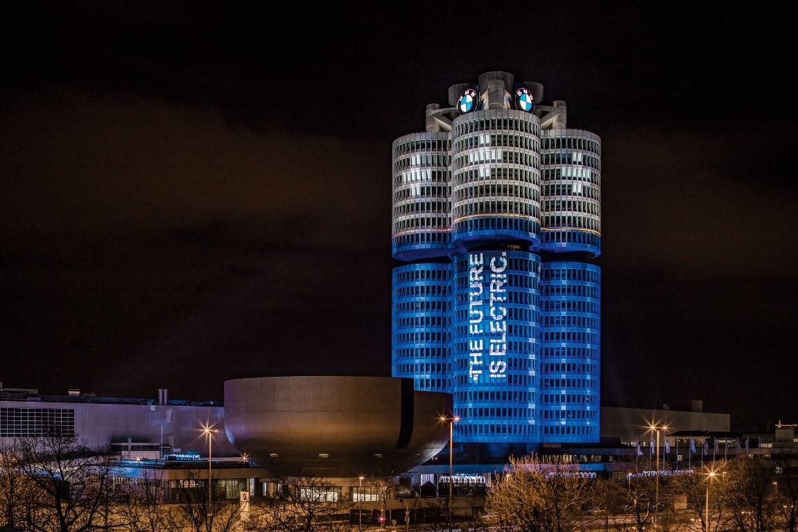 "The BMW Group has delivered more than 100,000 electrified vehicles to customers worldwide in 2017, as promised at the beginning of the year. An eye-catching light installation transformed the BMW Group headquarters, the world-famous ""Four-Cylinder"" in the north of Munich, on the evening of 18 December 2017 into a battery."