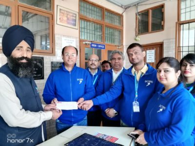 Officials of Rock & Storm Group donating items of need at 'Prabh Aasra'